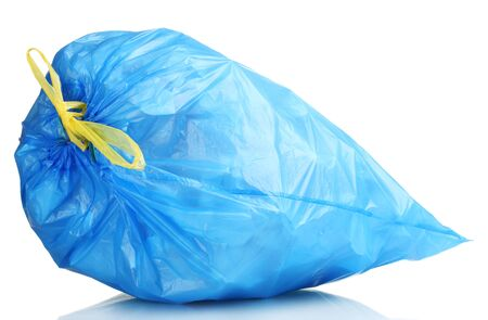 blue garbage bag with trash isolated on white photo