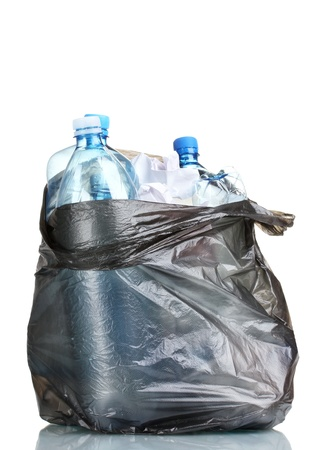 open black garbage bag with trash isolated on white photo