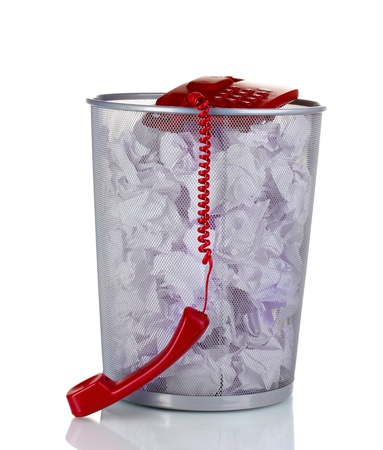 red phone and paper in metal trash bin isolated on white photo