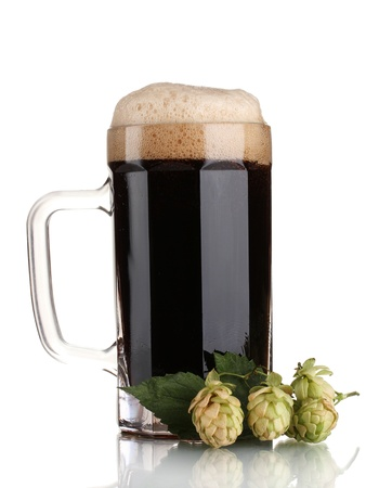 dark beer in a mug and green hop isolated on white photo