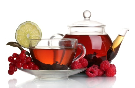 herbal tea: Black fruit tea in glass teapot and cup isolated on white