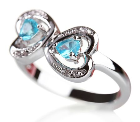 beautiful ring with blue precious stones isolated on white photo