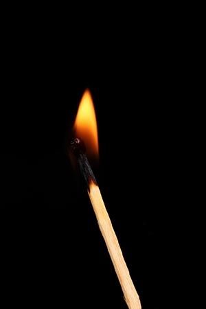 Burning match on black background Stock Photo - 11288190
