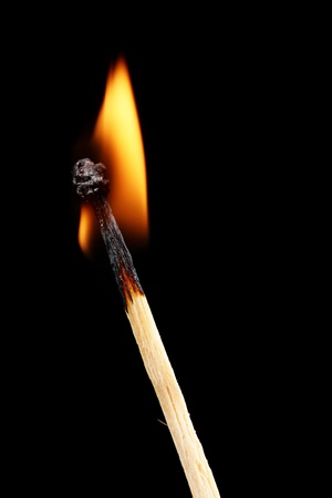 Burning match on black background Stock Photo - 11288192