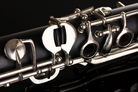 close up detail of clarinet on black background photo