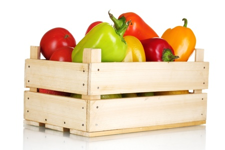 fresh paprica and tomatoes in wooden box isolated on white photo