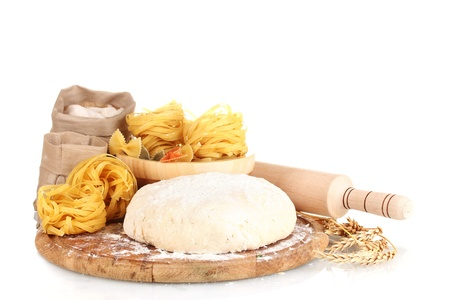 ingredients for homemade pasta on wooden plate isolated on white photo