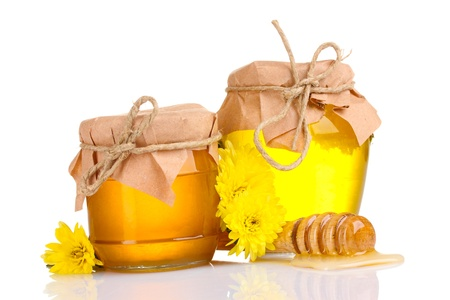 drizzler: two jars of honey and wooden drizzler isolated on white Stock Photo