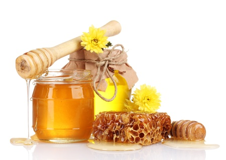 drizzler: two jars of honey, honeycombs and wooden drizzler isolated on white