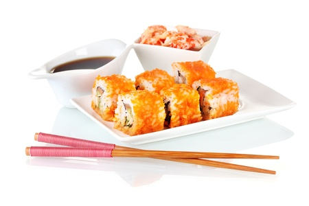 delicious sushi on plate, chopsticks, soy sauce and shrimps  isolated on white Stock Photo - 11288554