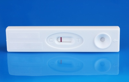 first miracle: pregnancy test on blue background