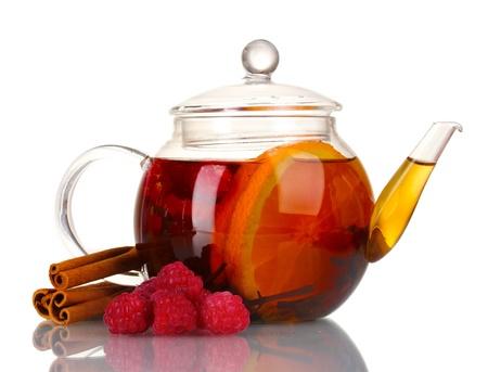 Glass teapot with black tea of raspberries,orange, cinnamon isolated on white photo