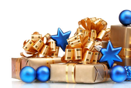 Beautiful gifts in gold packaging and Christmas balls isolated on white photo