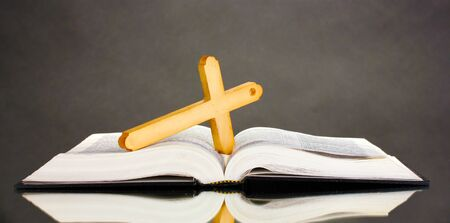 Russian bible and wooden cross on black background Stock Photo - 11417850