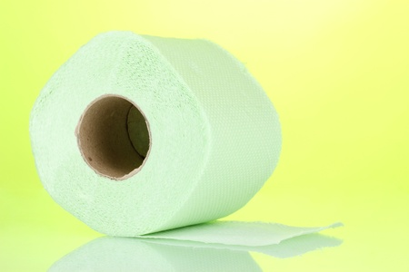 green roll of toilet paper on green background photo