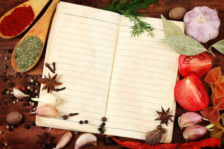 notebook for recipes and spices on wooden table Stock Photo - 11399574