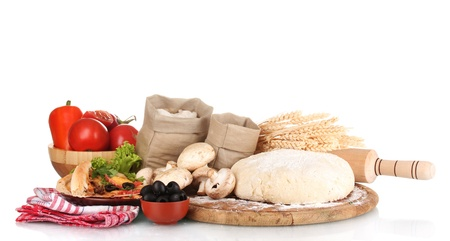 pizza ingredients: delicious pizza, dough and vegetables isolated on white Stock Photo