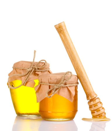 pot of gold: two jars of honey and wooden drizzler isolated on white Stock Photo