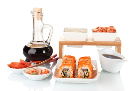 delicious sushi on plate, chopsticks, soy sauce, fish and shrimps isolated on white Stock Photo - 11418069