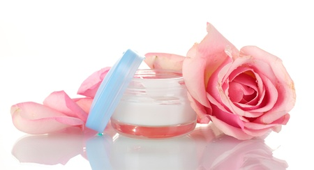 Face cream with pink roses isolated on white photo