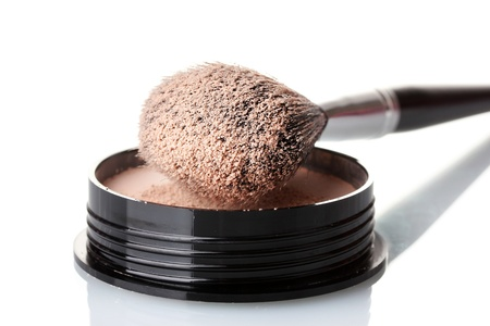 colorant: closeup of face powder and brush isolated on white