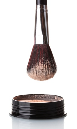 makeup a brush: closeup of face powder and brush isolated on white