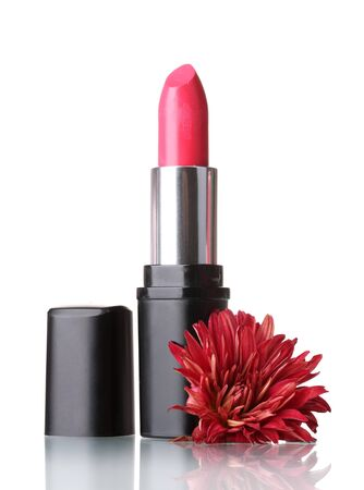 New lipstick and flower on the white background photo
