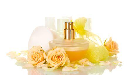 Hotel amenities kit and perfume on white background photo