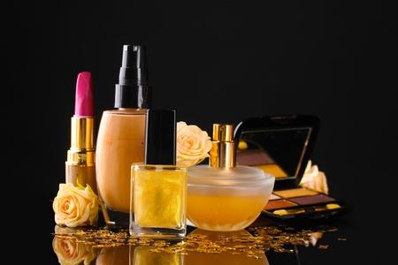cosmetics isolated on black photo