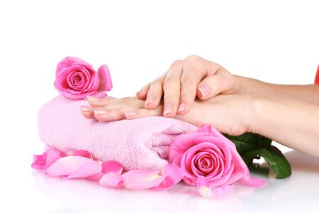 Pink towel with roses and hands on white background Stock Photo - 11407417