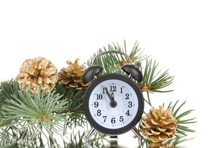 watch new year: Green Christmas tree and clock isolated on white Stock Photo