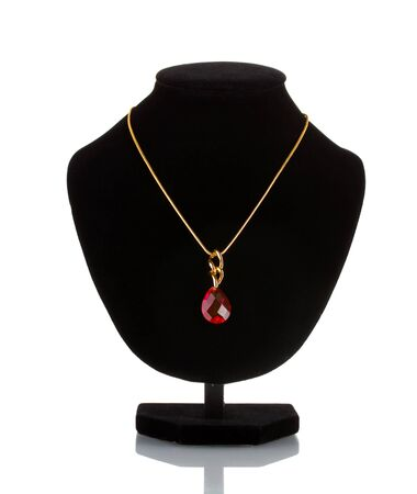 Pendant with red gem on mannequin isolated on white photo