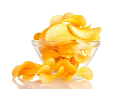 Delicious potato chips in bowl isolated on white photo