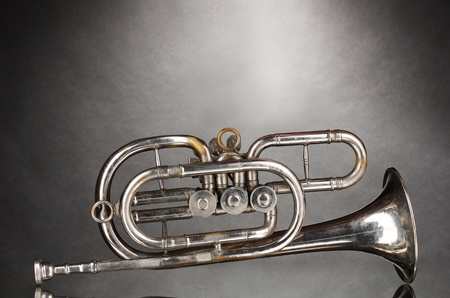 old trumpet on gray background photo