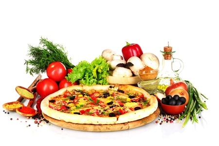 ingredient: delicious pizza on wooden board, vegetables, spices and oil isolated on white