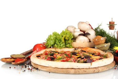 delicious pizza on wooden board, vegetables, spices and oil isolated on white Stock Photo - 11517324