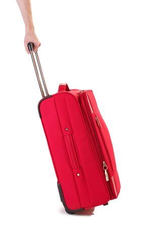 Red suitcase isolated on a white photo