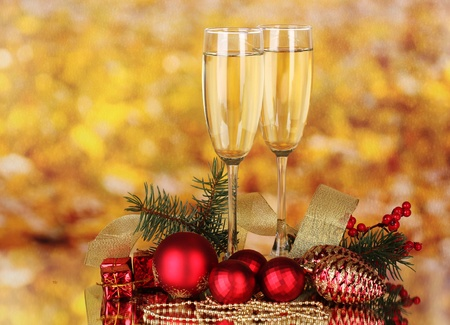 wine glass christmas: Two glasses with christmas decoration on yellow