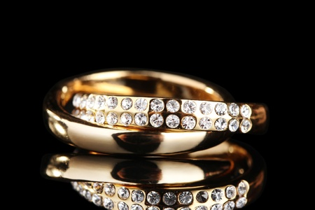 silver jewelry: Golden ring on black Stock Photo