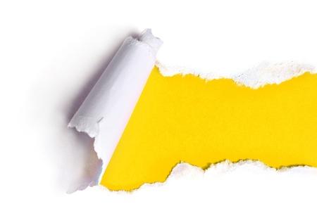Torn papír se žlutým pozadím Reklamní fotografie