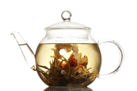 exotic green tea with flowers in glass teapot isolated on white Stock Photo - 11512032