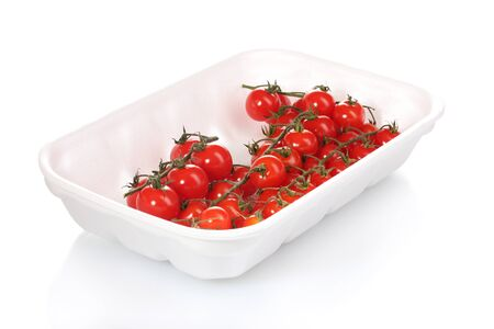 cherry tomatoes in packaging isolated on white photo