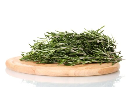 lavage: fresh green rosemary on wooden board isolated on white Stock Photo