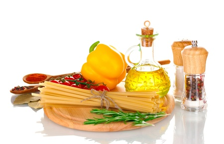 spaghetti, jar of oil, spices and vegetables on wooden board isolated on white Stock Photo - 11517320