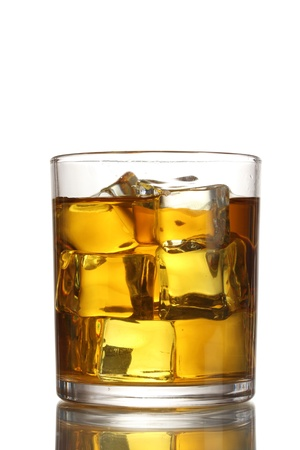whisky: glass of whiskey and ice isolated on white