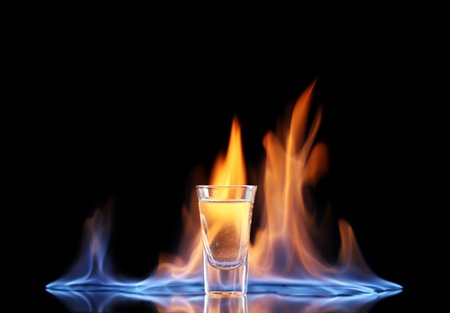 Flaming vodca on black background
