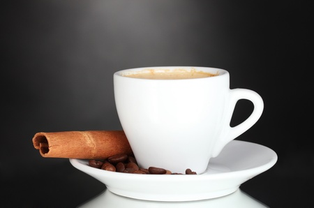 cup of coffee, cinnamon and coffee beans on black background Stock Photo - 11665117