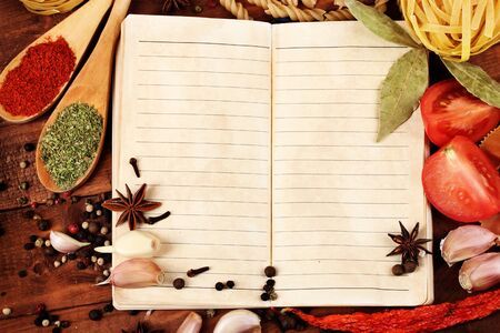 notebook for recipes and spices on wooden table Stock Photo - 11665397