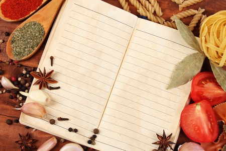 notebook for recipes and spices on wooden table Stock Photo - 11665430