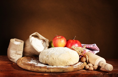 ingredients for homemade pie on wooden table on brown background photo